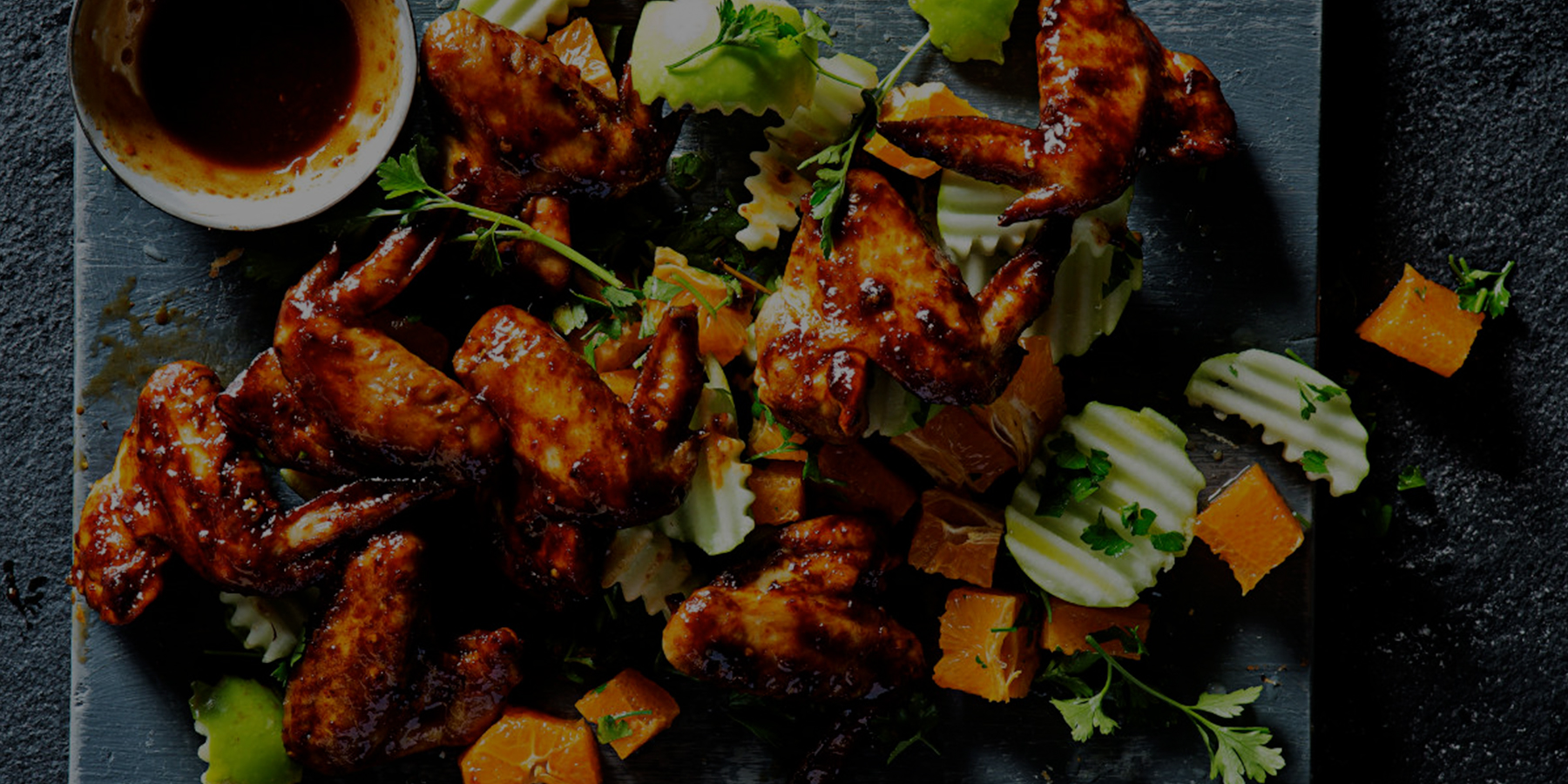 Sticky wings with apple and orange salsa